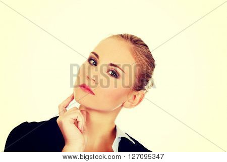 Young worried business woman thinking about something