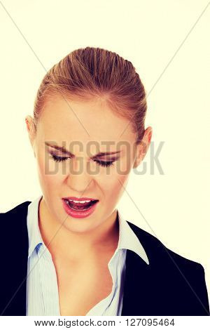 Angry young business woman screaming