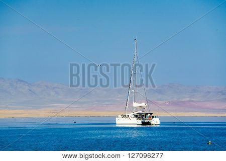 White ship in the South Pacific Ocean at Paracas Peru