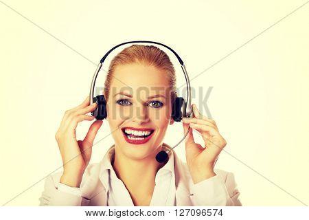 Smiling female phone operator in headphones