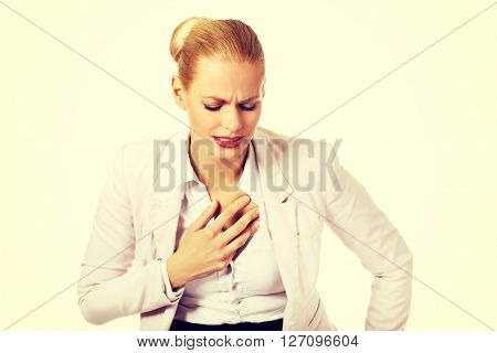 Young business woman having heart disease