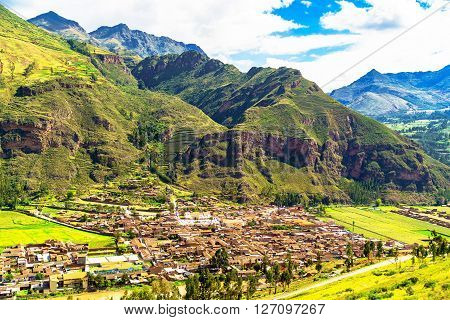 View of Pisac village and the Willkanuta River at the Sacred Valley of the Incas in Peru