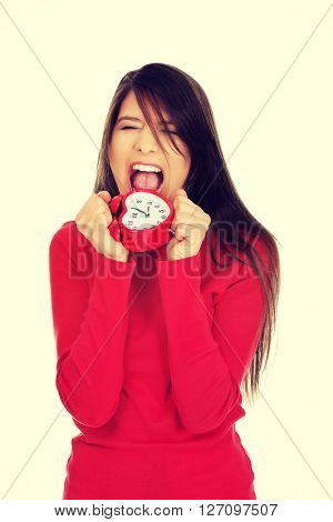 Angry woman with alarm clock.