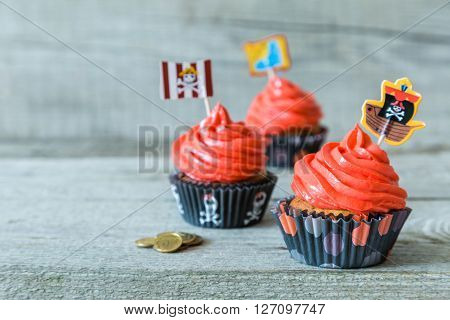 Colorful pirate theme birthday cupcakes, copy space