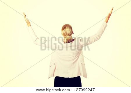 Back view of business woman trying to catch something