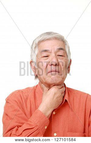 portrait of senior Japanese man having throat pain on white background