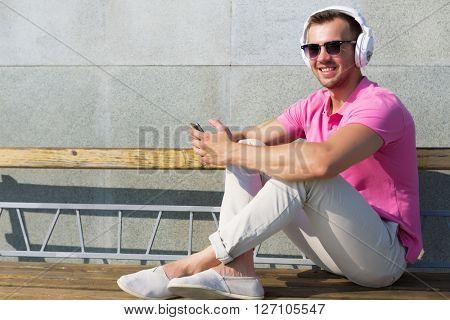 Guy in headphones enjoying music