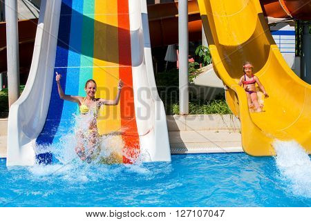 Children on water slide at aquapark.