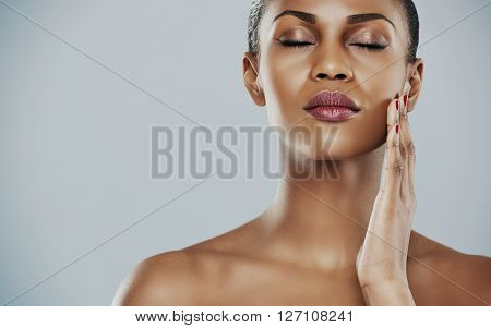 Serene Woman With Closed Eyes And Touching Cheek