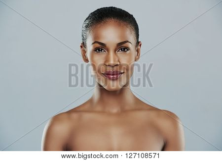 Woman With Bare Shoulders Over Gray Background