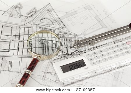 architecture blueprints -  house, compass, electronic calculator & magnifying glass