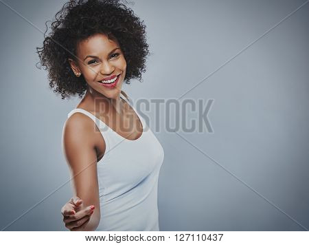 Beautiful Happy Woman Dancing Over Gray Background