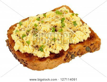 Scrambled egg on toast with cress isolated on a white background