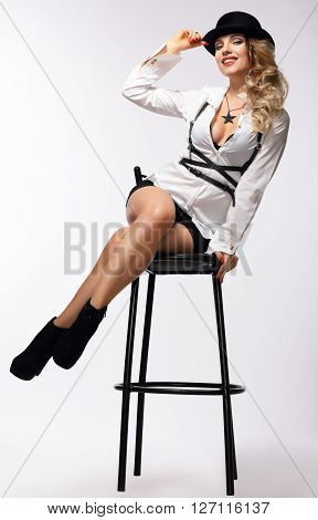 Beautiful Woman On A Chair.