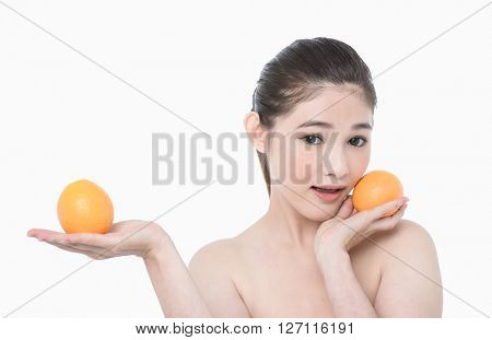 Portrait of beautiful sexy girl on a white background with orange