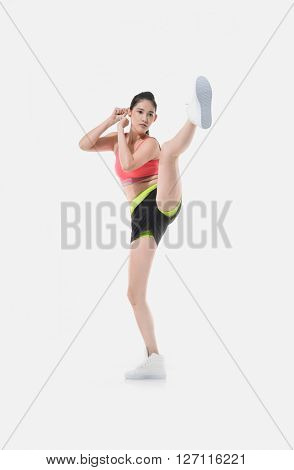 Pretty young woman boxing on white background