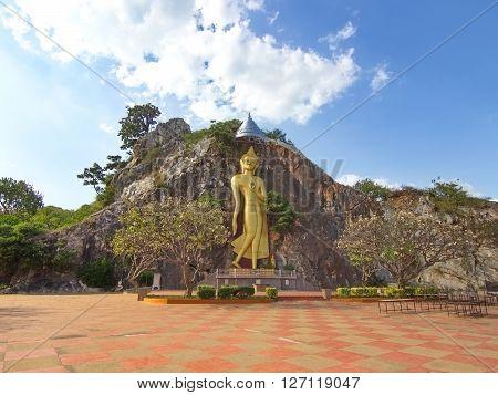 Buddha on the cliff at Khoa Ngoo in Ratchaburi Thailand