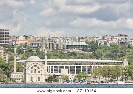 ISTANBUL,TURKEY, APRIL 21, 2016: Exterior shot of Dolmabahce Mosque and Besiktas Vodafone Arena Stadium at Dolmabahce District of Besiktas, Istanbul, Turkey.