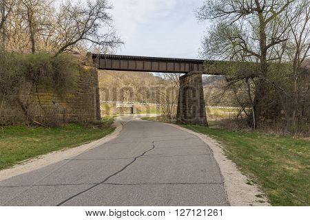 A road passing under a railroad bridge.