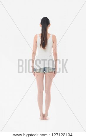 Back view portrait of a young woman in sports wear over white background