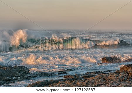 Waves in the first rays of the sun off the Eastern Cape coast of South Africa