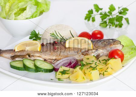 Baked trout with potato, cherry tomatoes and green salad