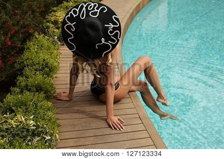 Gorgeous Sexy Woman With Blond Hair Wears Elegant Swimsuit