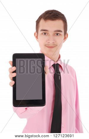 Boy in a pink shirt hold a tablet PC isolated on white. Shallow depth focus on tablet PC