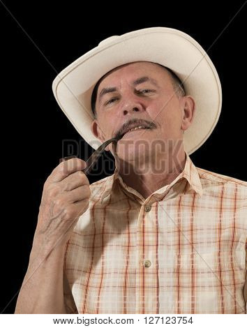 Cowboy in white hat with Pipe . April 2016