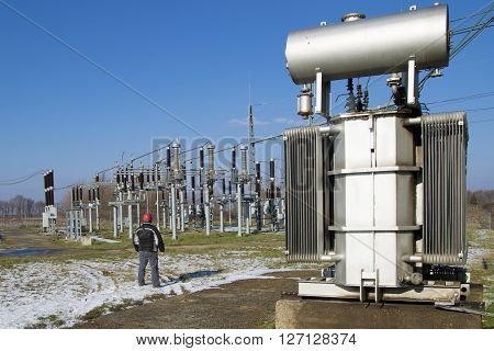 High voltage switchyard and transformers in electrical substation