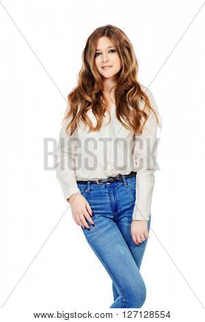 Pretty smiling girl in white blouse and jeans. Youth fashion. Isolated over white.