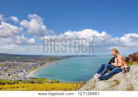 Bray town (Ireland) as seen from Bray Head and two girls on it
