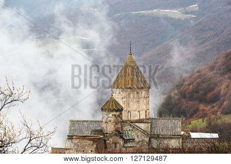 Ancient monastery Tatev covered with clouds in the mountains of Armenia. Was founded in year 906.