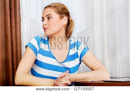 Young woman sitting at the desk