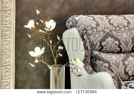vase with the flowers near a magnificent sofa