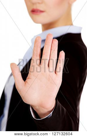 Young business woman shows stop gesture