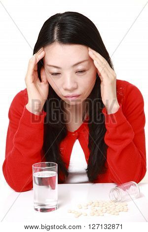 Japanese woman suffers from melancholy on white background