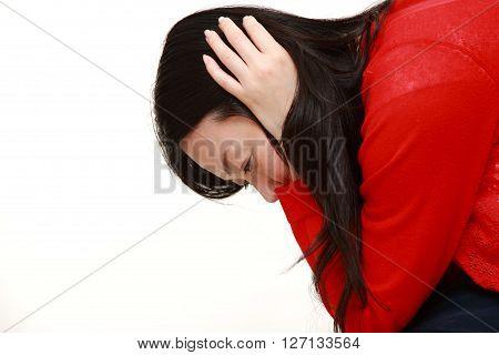 studio shot of depressed woman on white background
