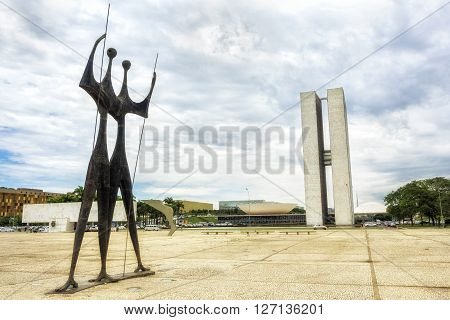 Brasilia Brazil - November 18 2015: Brazilian National Congress (Congresso Nacional) building and Dois Candangos Monument in Brasilia capital of Brazil.