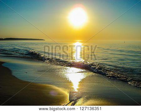 Beautiful golden sundown over the sea. The sunset on the coastline