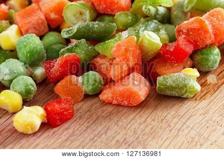 Frozen vegetables on cutting board for cooking. Closeup