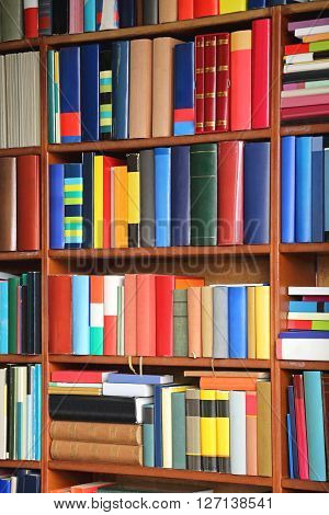 Colorful Books at Book shelf in Library