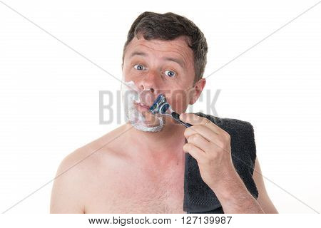 Handsome Man In His Bathroom Shaving In The Morning
