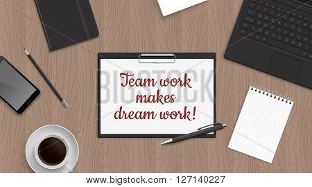Quote Team work make dreamwork in folder plate on office table. Top view workplace with gadget and stationery and coffee. Work inspiration quote.