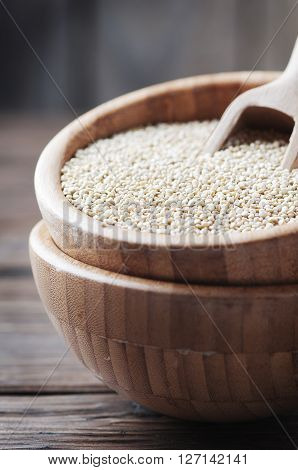 Uncooked Quinoa On The Wooden Table