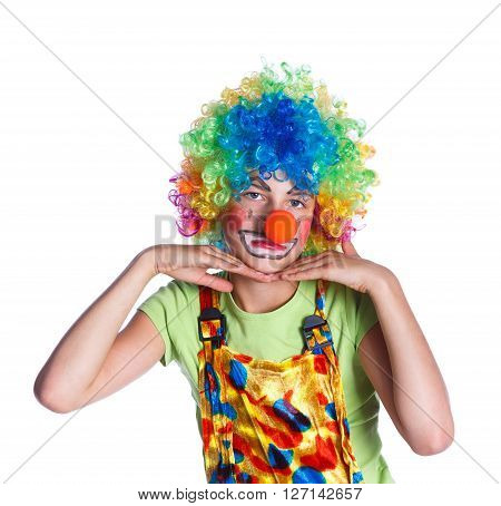 Cute girl dressed as a clown isolated in white