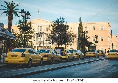 ATHENS, GREECE- JUNE 12, 2015: Street traffic with many yellow taxis in Athens, Greece.