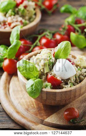 Vegetarian Healthy Salad With Quinoa, Tomato And Avocado