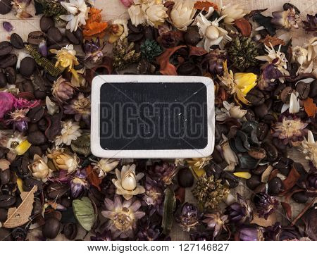Flower tea petals on wooden background