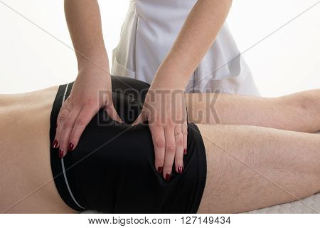 Female Physiotherapist Doing A Buttock Massage Isolated
